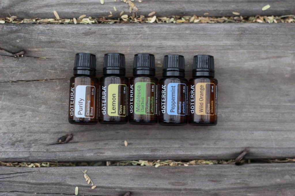 bottles of DoTERRA oils: Purify, Lemon, Melaleuca, Peppermint, Wild Orange
