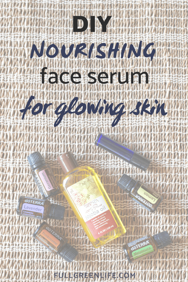 "Jojoba oil bottle with bottles of DoTERRA melaleuca, lavender, geranium, frankincense, and lemon with text overlay ""DIY nourishing face serum for glowing skin"""