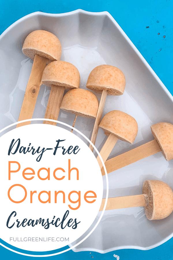 peach orange creamsicles on a white dish