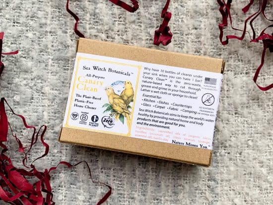 Close up of Sea witch Botanicals all purpose soap inside the cardboard packaging, laying on a gray blanket
