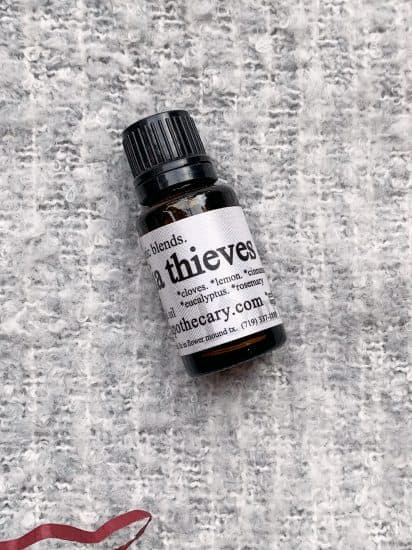 closeup of Thieves essential oil blend in a glass bottle