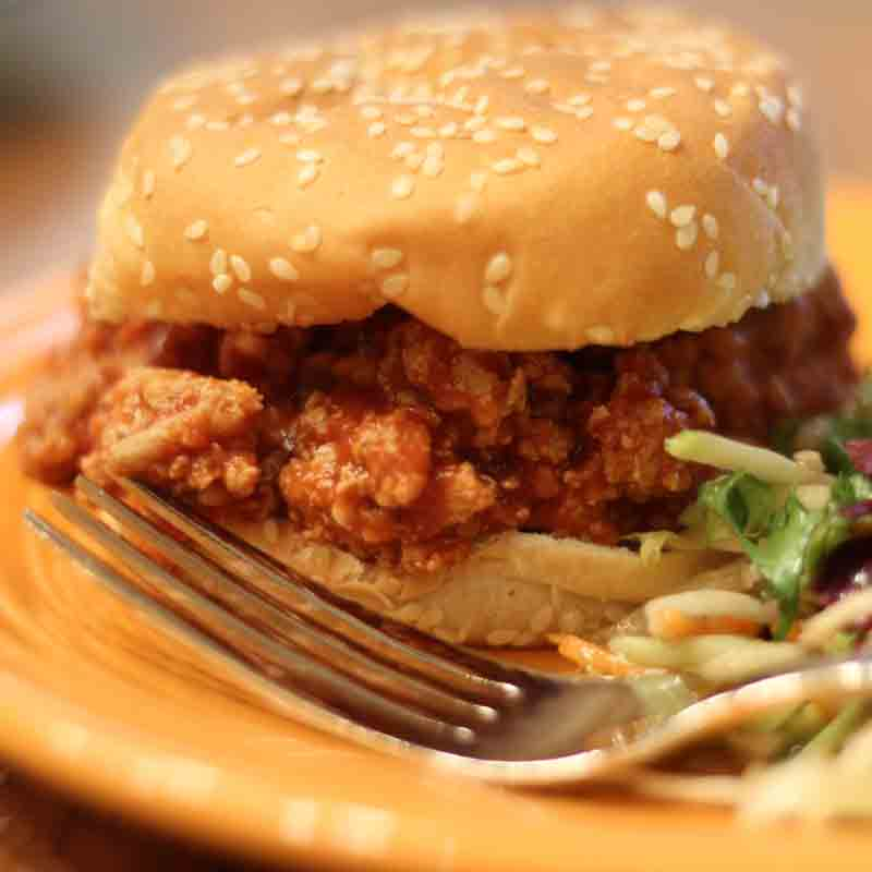 turkey sloppy joe on a bun on a plate with a fork