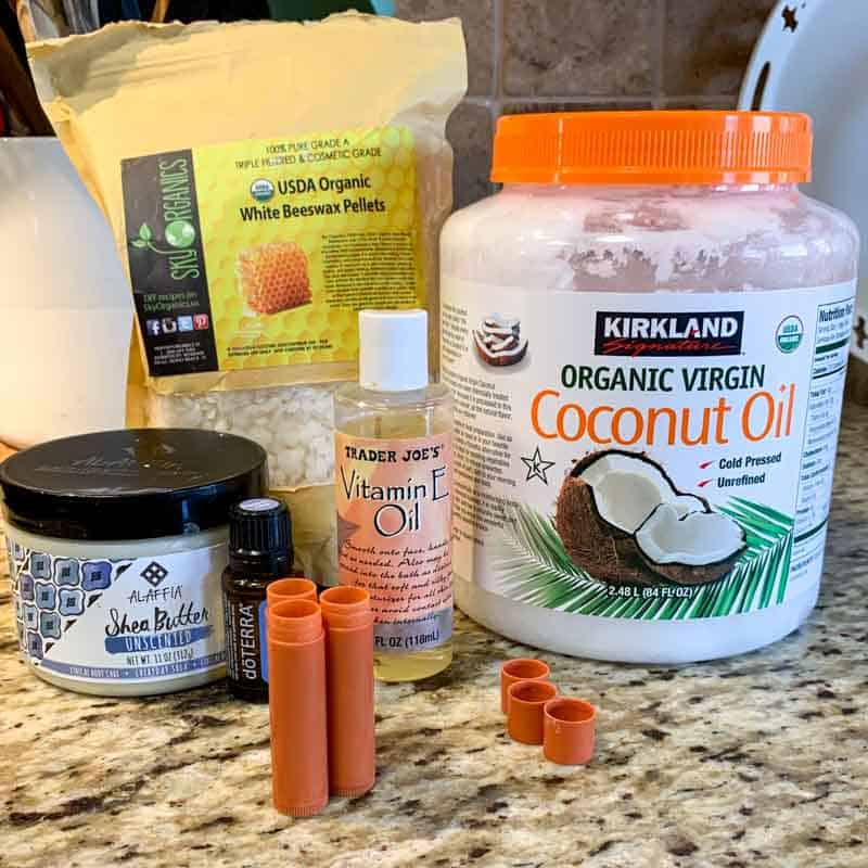 ingredients for DIY lip balm-beeswax pellets, coconut oil, shea butter and Vitamin E oil