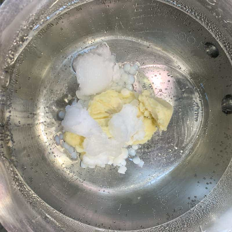 shea butter, beeswax, and coconut oil in double boiler