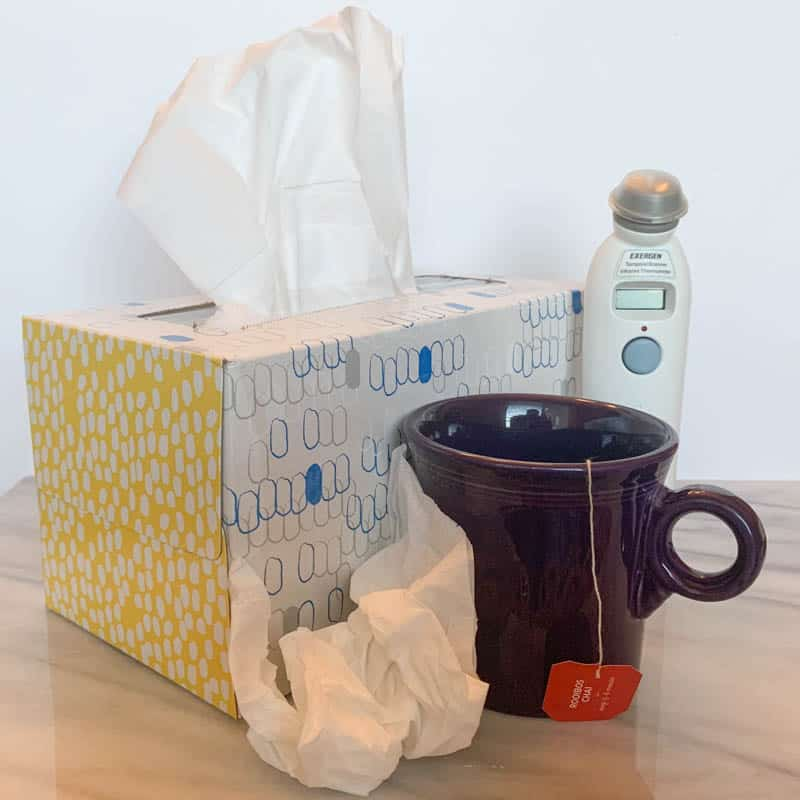 tissue box, mug of tea, digital thermometer