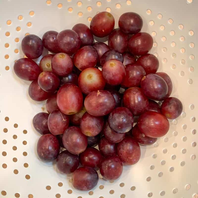 red grapes after soaking in vinegar solution