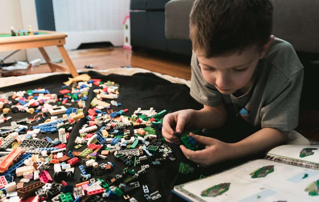 boy working on a lego project
